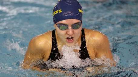 Emily Anderson wins the 100 breaststroke for Shoreham-Wading