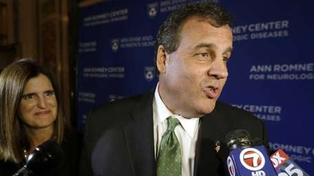New Jersey Gov. Chris Christie, right, speaks with