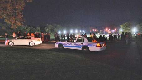 Police investigate the scene at Half Hollow Hills