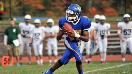 Roosevelt quarterback Stephen Vailes fades back for a