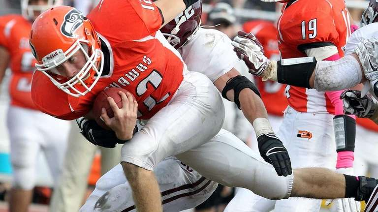 Carey QB Michael Catanese dives for more yards