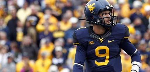 Clint Trickett of the West Virginia Mountaineers looks