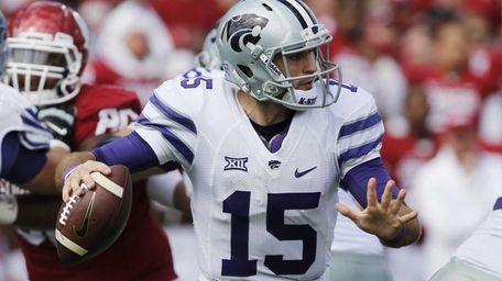 Kansas State quarterback Jake Waters passes in the