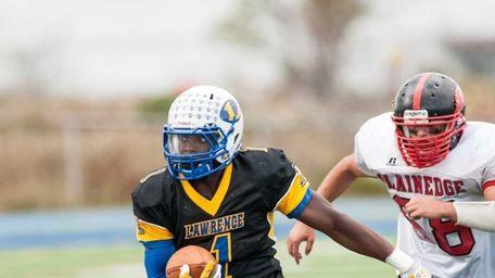 Lawrence's Jordan Fredericks runs against Plainedge on Saturday,