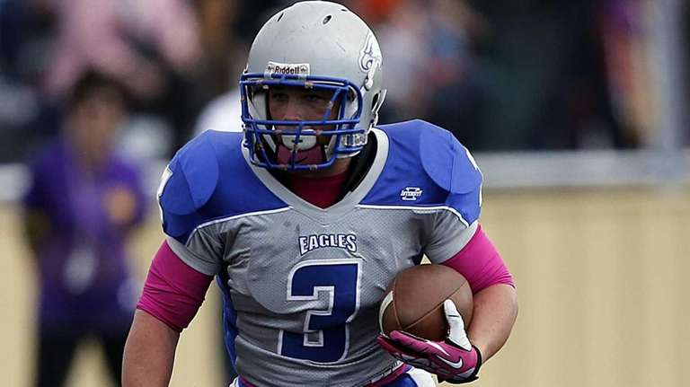 Hauppauge running back Marcus Bisono cuts back in