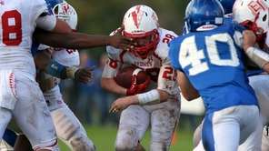 East Islip RB Sean Karika finds some running