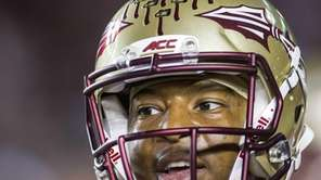 Florida State quarterback Jameis Winston warms up for