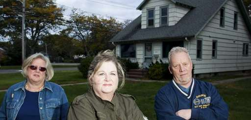 St. James residents, from left, Cheryl Jordan, 54,