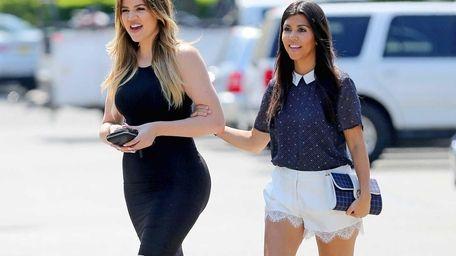Khloé, left, and Kourtney Kardashian head to lunch