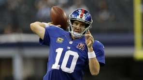 Giants quarterback Eli Manning (10) passes during warm-ups
