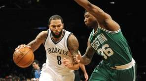 Nets guard Deron Williams (8) drives the ball