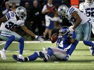 Dallas Cowboys cornerback Brandon Carr (39) watches as