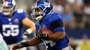 Giants rookie running back Andre Williams carries the