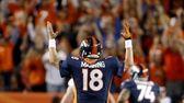 Denver Broncos quarterback Peyton Manning (18) signals a