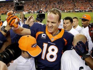 Denver Broncos quarterback Peyton Manning (18) celebrates his