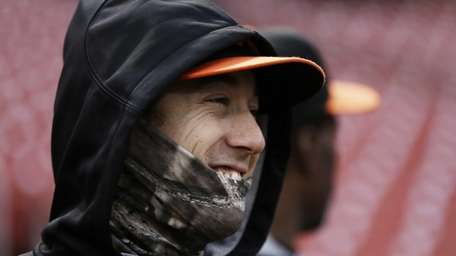 The San Francisco Giants' Tim Lincecum covers up