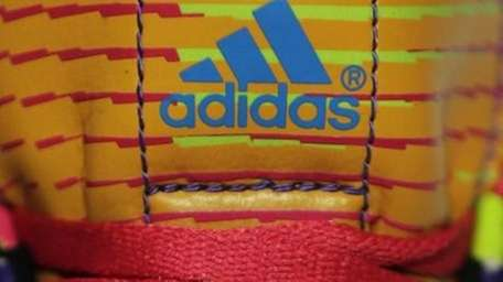 The adidas logo on a sports shoe during