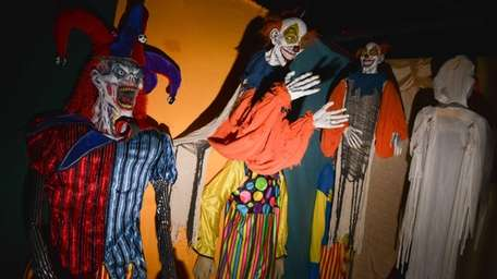 Terrifying clowns line the walls inside one of