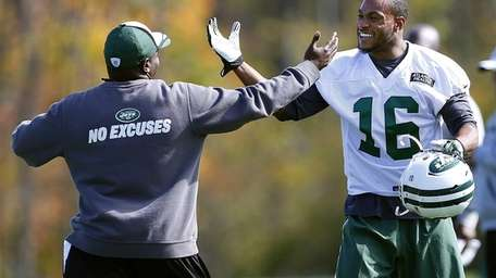 Jets wide receiver Percy Harvin (16) is greeted