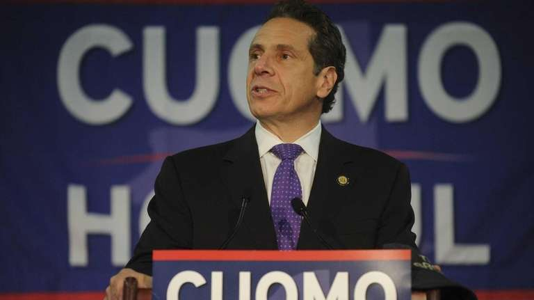 New York State Governor Andrew Cuomo holds a