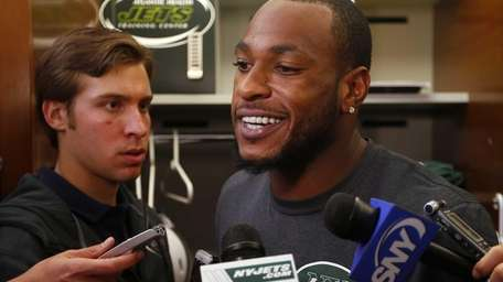 Jets wide receiver Percy Harvin talks to the