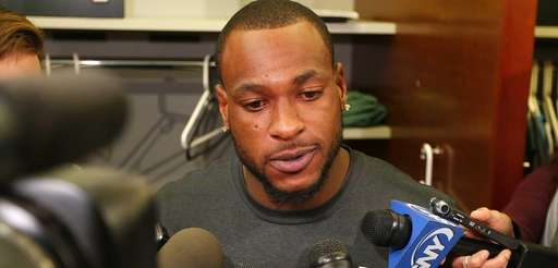Jets receiver Percy Harvin talks to the media