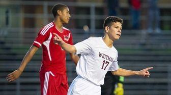 Whitman forward Witman Hernandez (17) celebrates after scoring