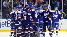 The Islanders celebrate after defeating the San Jose