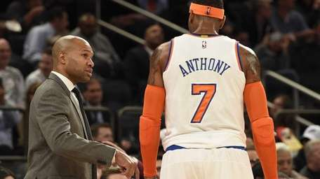 Knicks head coach Derek Fisher directs forward Carmelo