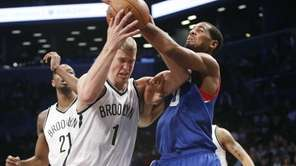 Nets forward Mason Plumlee (1) struggles to hold