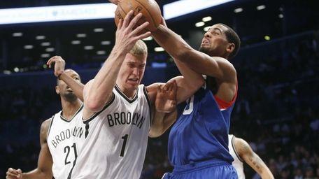 Nets forward Mason Plumlee (1) struggles to hold