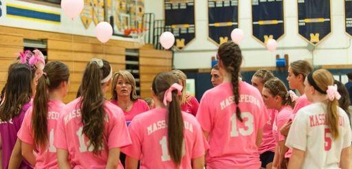 Massapequa coach Carol Ann Habeeb-Kiel (center, rear) talks