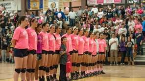 Massapequa's volleyball team lines up before a game