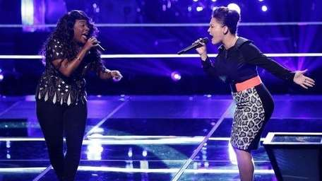Toia Jones and DaNica Shirey perform in the