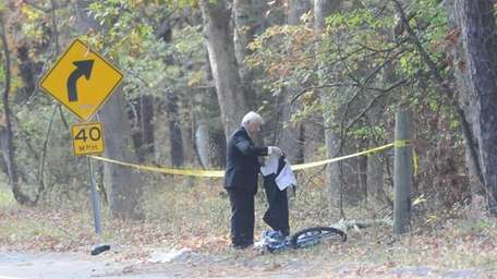 A detective near a bicycle at the scene