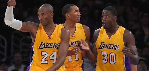 Los Angeles Lakers guard Kobe Bryant, left, gestures