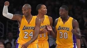 Los Angeles Lakers guard Kobe Bryant, left, gestures