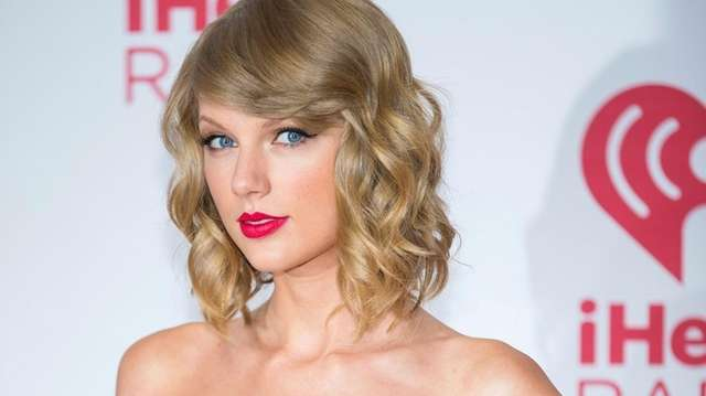 Taylor Swift arrives at the iHeart Radio Music
