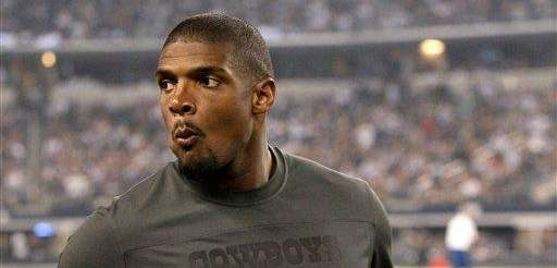 The Dallas Cowboys' Michael Sam walks along the