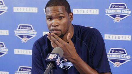 Oklahoma City Thunder forward Kevin Durant answers questions