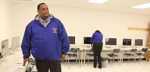 Hempstead School Board President Lamont Johnson stands in