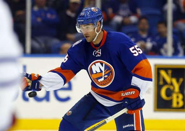 Johnny Boychuk of the Islanders plays the puck