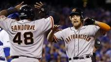 The San Francisco Giants' Hunter Pence is congratulated