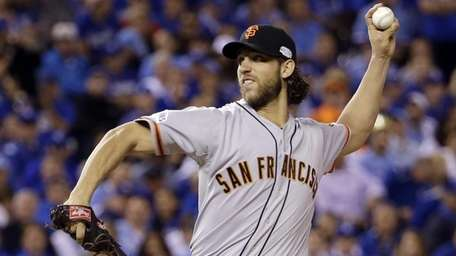 San Francisco Giants pitcher Madison Bumgarner throws during
