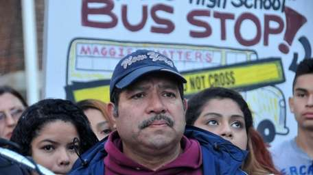 Cesar Rosales, center, father of Maggie Rosales, is