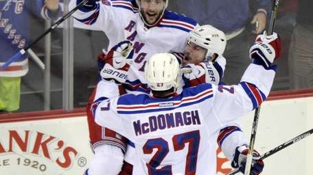 Rangers' Kevin Klein celebrates his game-winning goal in