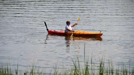 A kayaker paddles through the waters of Inner