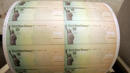 Blank U.S. Treasury checks are seen on a
