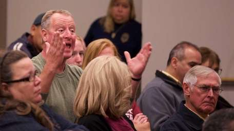 Alfred O'Donnell, left, of Huntington Station, speaks during