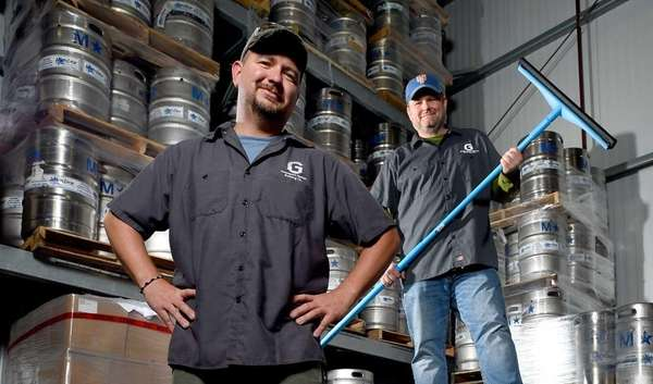 Head brewer DJ Swanson, left, and brewer Joe